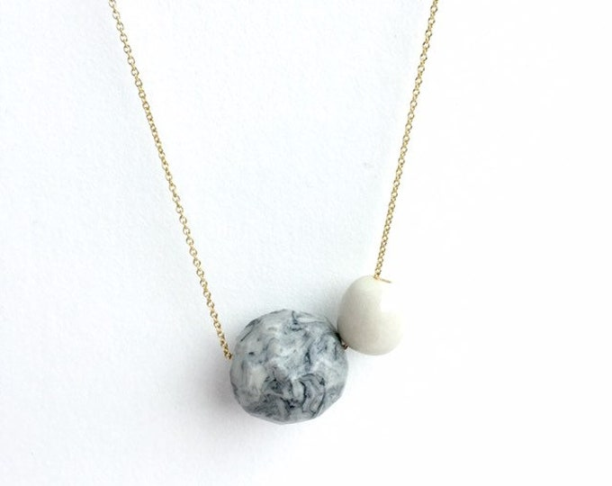 geometric porcelain necklace //faceted marbled sphere + pearly porcelain round