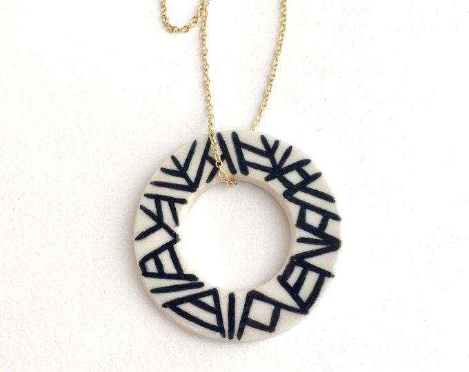 porcelain necklace // black lines on large ring pendant