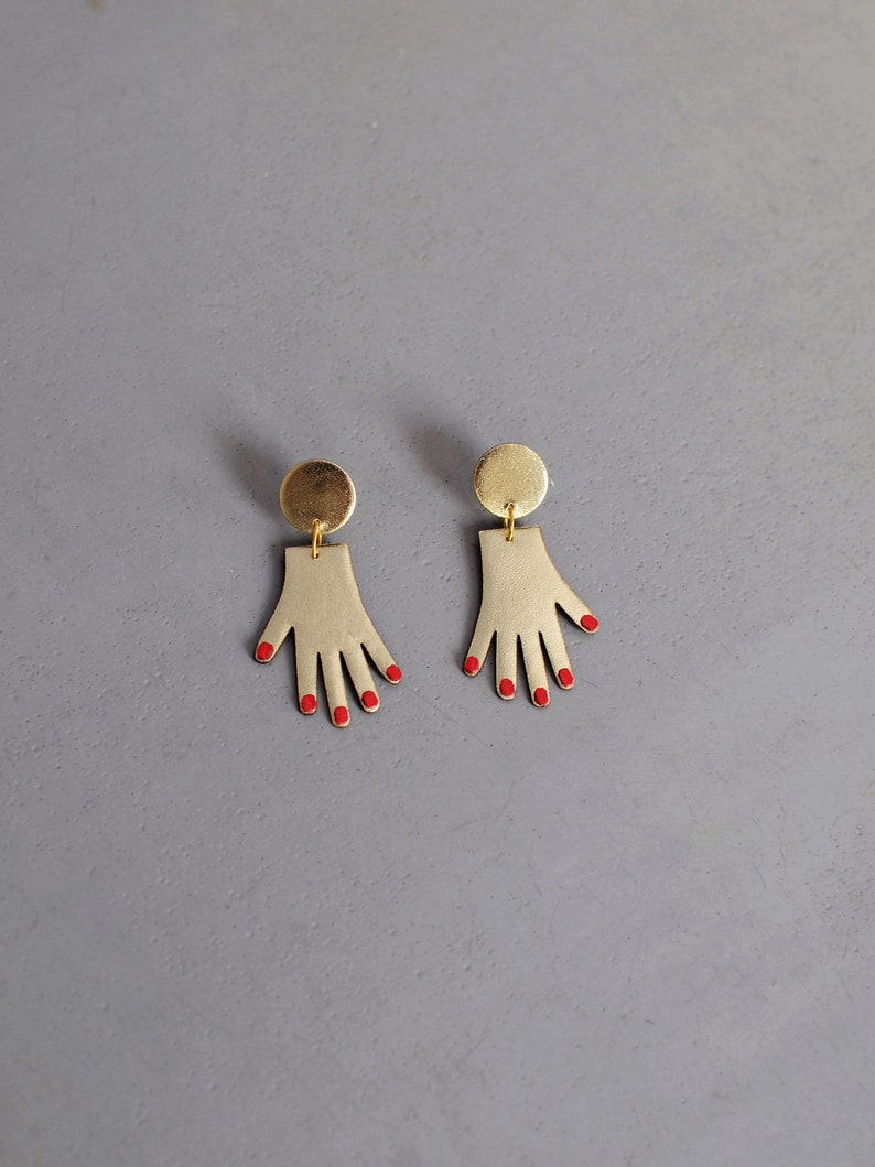 Hand earrings in gold and red leather image 0