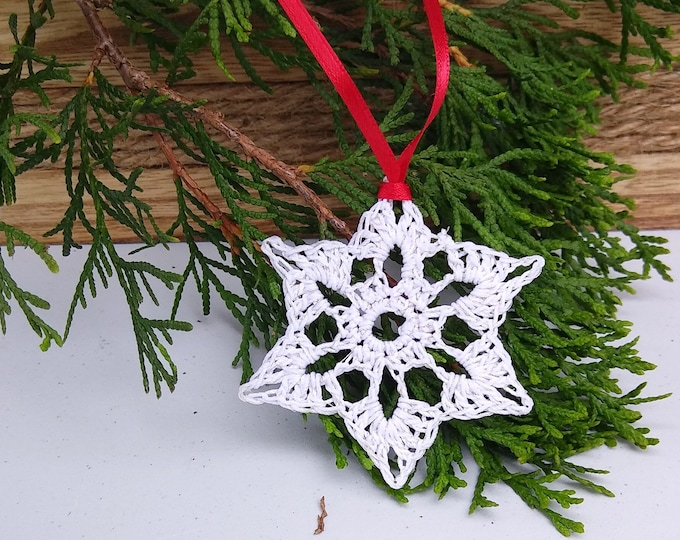 star shaped white snowflake ornament crocheted with silver sparkle