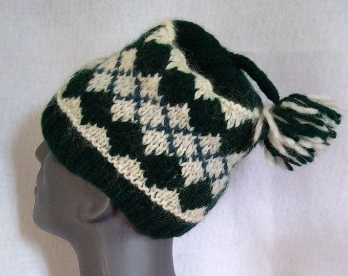 Men's winter hat hand-knit in nordic style pattern of green and white from bulky weight lopi-style yarn. In stock, ready to ship