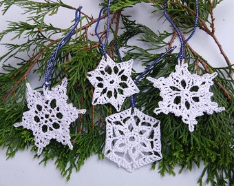 Set of 4 white crochet snowflakes with silvery accents, perfect for winter decor, holiday sparkle, Christmas tree ornaments, bridal event