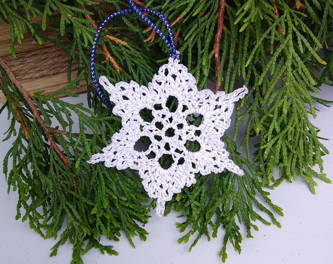 White crochet snowflake ornament with silver sparkle,