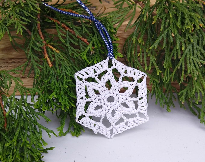Victorian snowflake crocheted in white cotton with silver sparkle