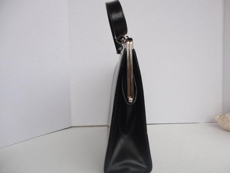 Black Triangle Purse With Decorative Silver Tone Accents