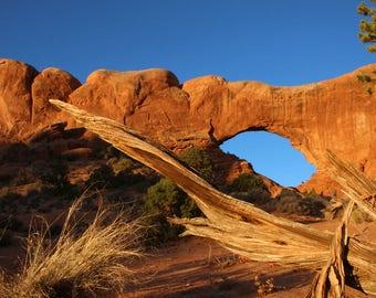Arches North Window sunrise, Arches National Park, Utah, photography, blue sky, rocks, orange, scenery, landscape, fine art, Val Isenhower