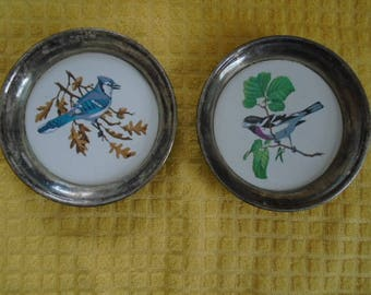 Set Of 2 Silver Plated Casters With Ceramic Birds In Middle