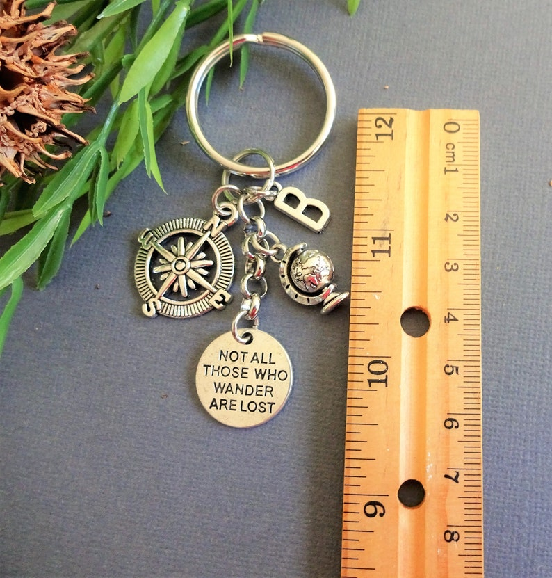 Not all those who wander are lost compass globe keyring