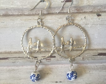 Bird in silver circle and oriental bead earrings