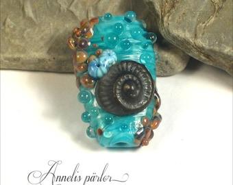 Handmade lampwork glass ammonite focal bead, Artisan lampwork bead, jewelry supplies, Swedish glass craft, SRA