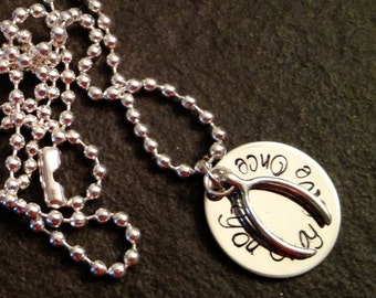You Only Live Once hand stamped necklace with wishbone charm