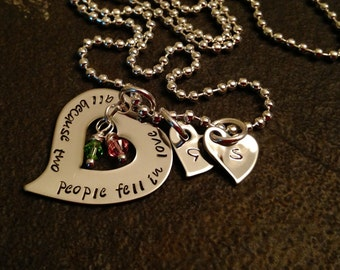 Personalized necklace hand stamped all because two people fell in love with Swarovski crystal birthstones