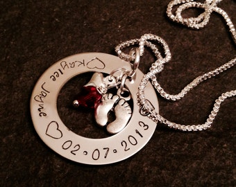 Hand stamped personalized mothers necklace with child name and birthdate birthstone and baby feet charm