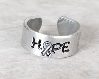 Personalized hand stamped ring hope ring cancer awareness epilepsy awareness military deployment hope rubbing find a cure for a cause sale