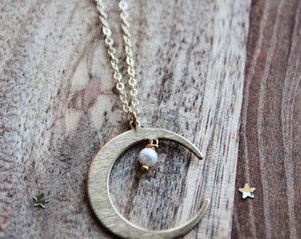 Moon and pearl necklace