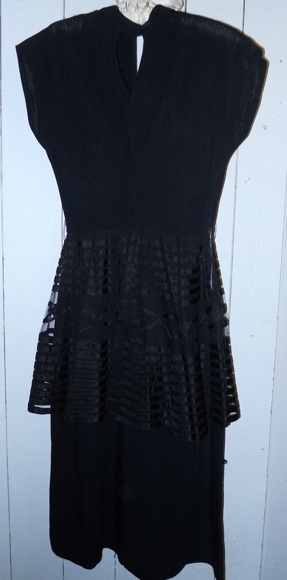 1940's black dress with net and ribbon peplum. PER