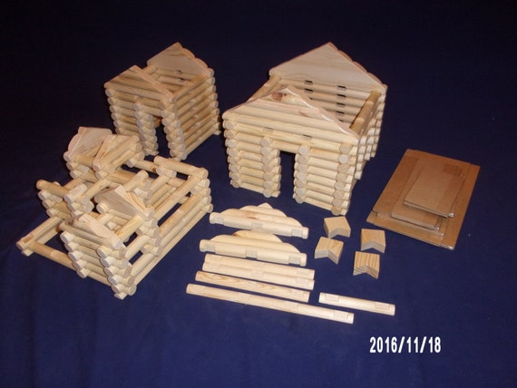 210 piece handmade 'Lincoln Logs' set in sturdy clear plastic storage tub