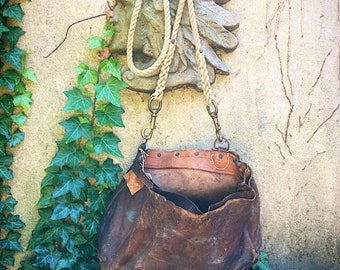 Large leather bucket bag on sailor's rope strap