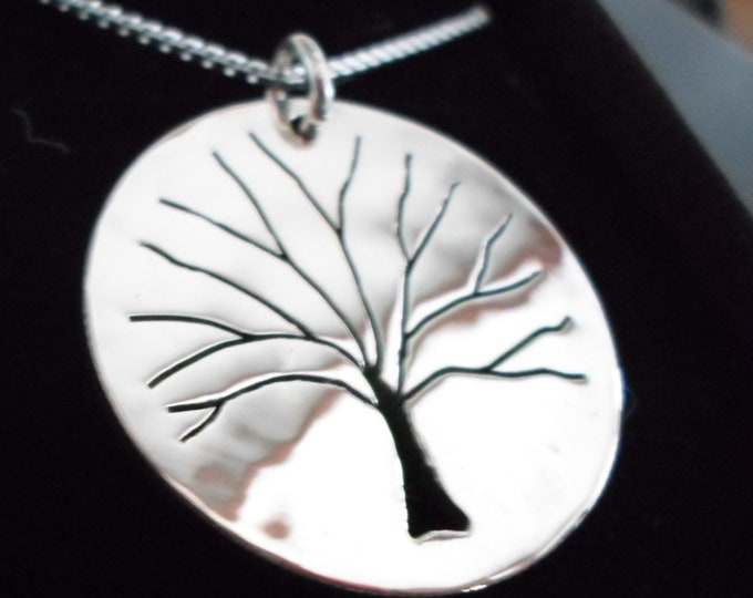 Tree of life half dollar size solid back w/sterling silver chain