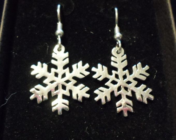 snowflake quarter size earrings