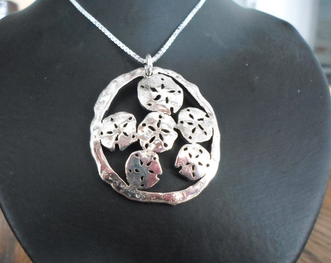 Large melted explosion of sand  dollars  w/sterling silver chain