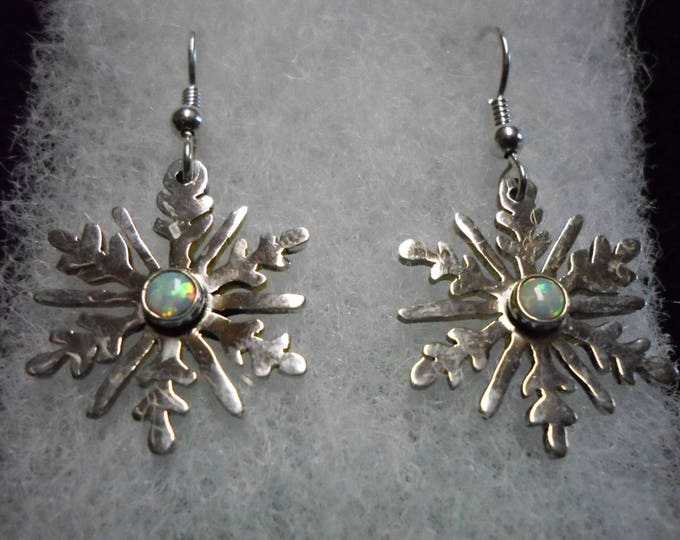 created opal snowflake earrings quarter size