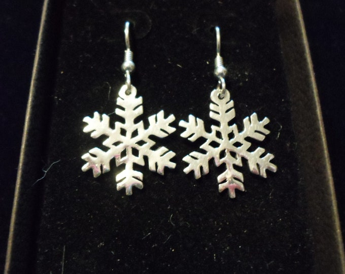 snowflake earrings hand pierced originals sterling silver by Mountain man