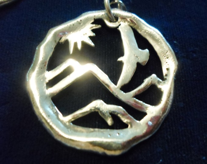 Large eagle over mountains necklace melted w/sterling silver
