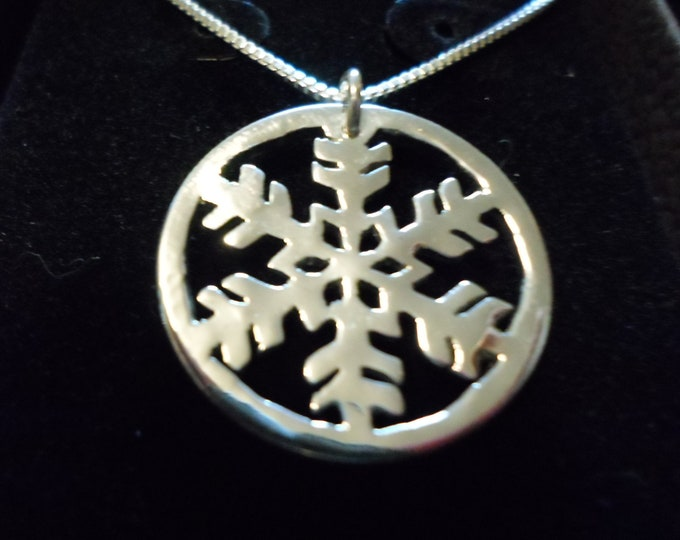 snowflake quarter size w/rim and sterling silver chain