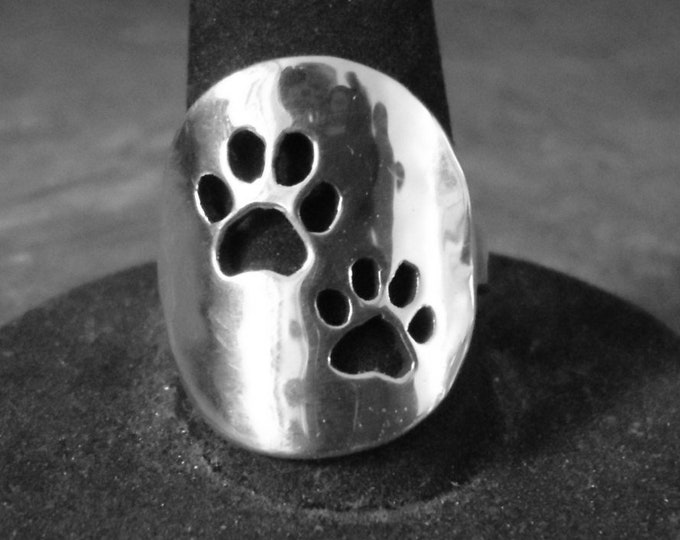 two dog paw ring quarter size