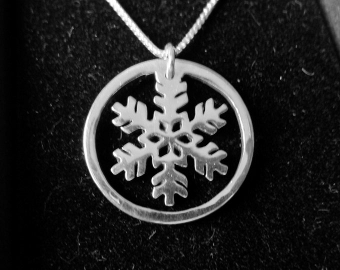 Snowflake dime size w/rim and sterling silver chain