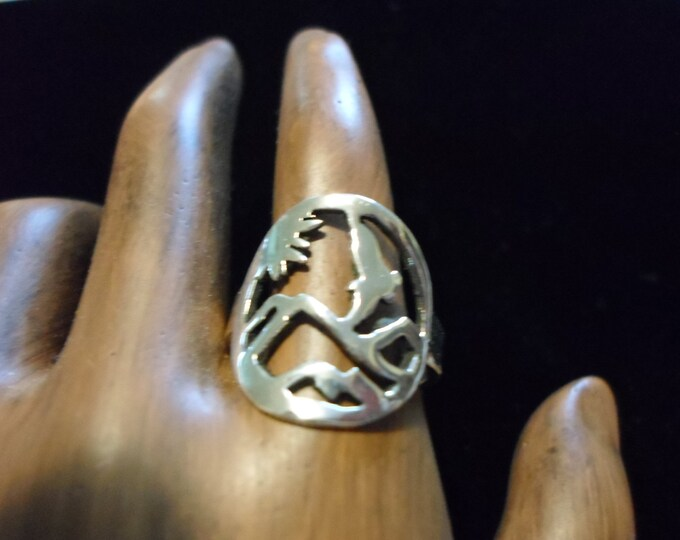 Eagle over mountains ring dime size
