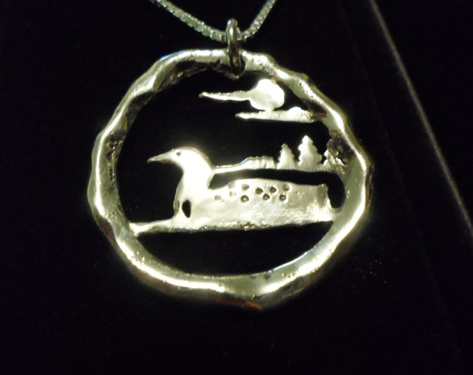 Melted Loon half dollar size w/sterling silver chain