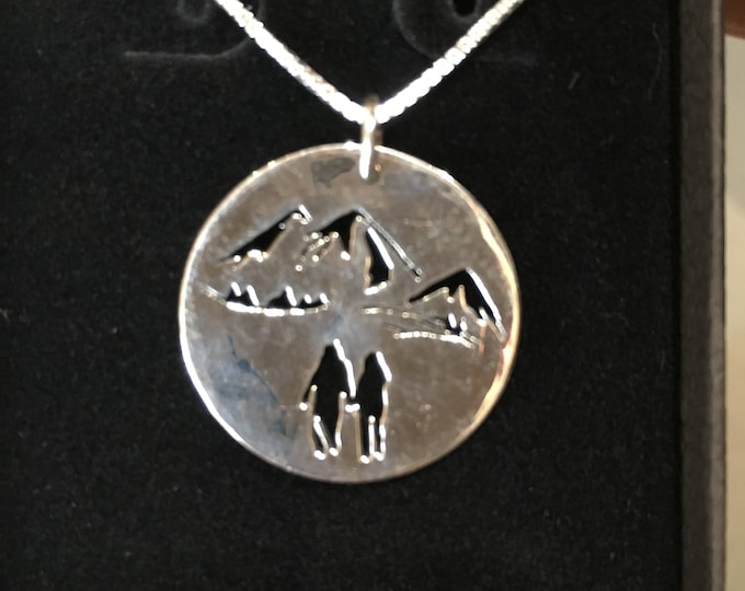 Walking in the mountains quarter size w/sterling silver chain