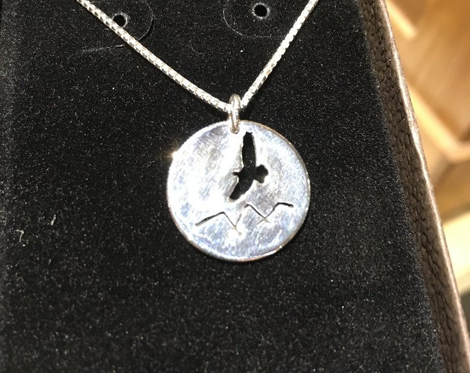 Eagle over mountains dime size w/sterling silver chain
