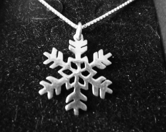 Snowflake  quarter size w/sterling silver chain