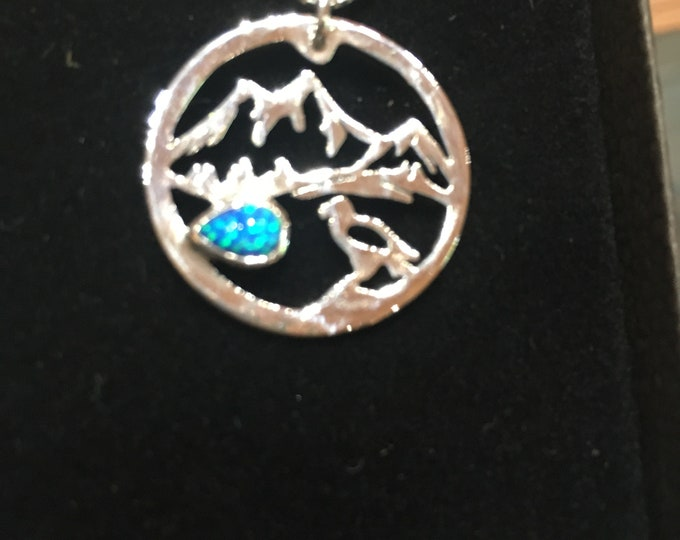 Hawk,mountains and lake necklace quarter size with silver silver chain and blue opal