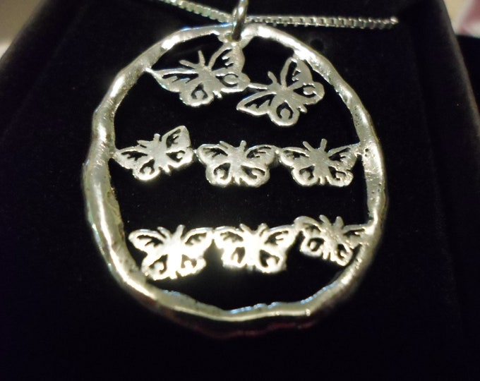 Butterfly explosion necklace w/sterling chain