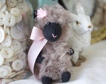Fuzzy sheep gray sheep with pink bow and flower