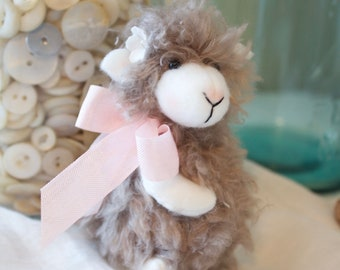 Fuzzy sheep with pink bow