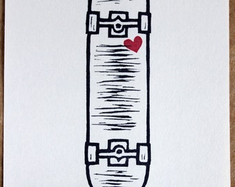 Skateboard and Heart. Hand made relief stamp print of a modern era shaped skateboard and heart, signed and numbered in an edition of 65