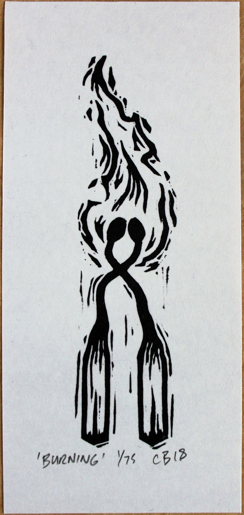 Burning  Linocut print of two burning matches. A signed and image 0