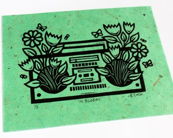 In Bloom (Green) - A linocut print on green natural fibre paper - signed and numbered in an edition of 8