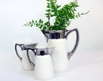 Antique Set 3 Geschutzt (Germany) Glazed Pottery Pitchers - White w/ Silver Band & Silver Rim - 1 Large 2 Small Matching Pitchers - Set of 3