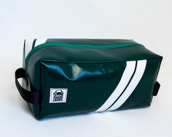 Wash bag / pencil case made of dark green truck tarpaulin with inner compartments