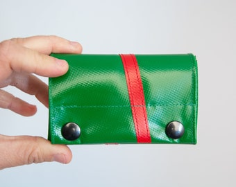 small purse made of truck tarpaulin green and red, with snap buttons