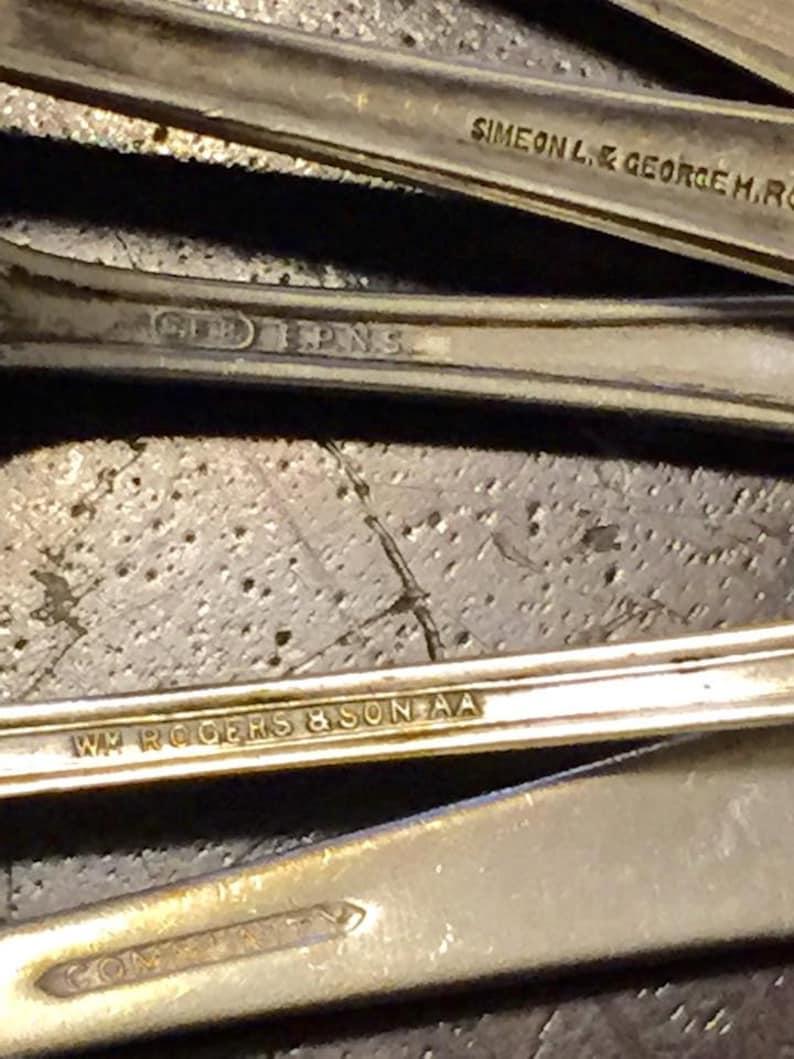Collection de 10 cuillères métal argentés Antique