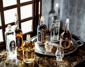 The Variance Set of 3-Etched Glass Spirit Decanters-Style your home bar, bar cart or give a gift to the drinking enthusiasts in you life.