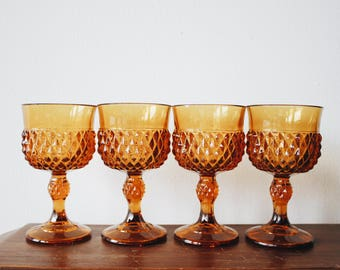 Vintage amber Indiana Glass stemmed water goblets | Orange Indiana Glass Diamond Point footed glassware |  Set  of mid century wine glasses
