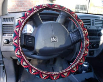 A Turquoise/Rust Aztec print, Steering Wheel Cover Custom Made.